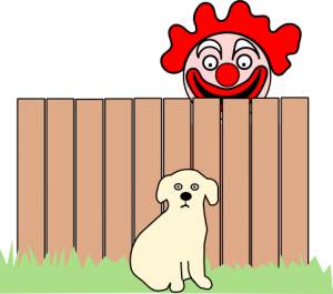 Puppy sitting in yard while scary clown peeps over fence